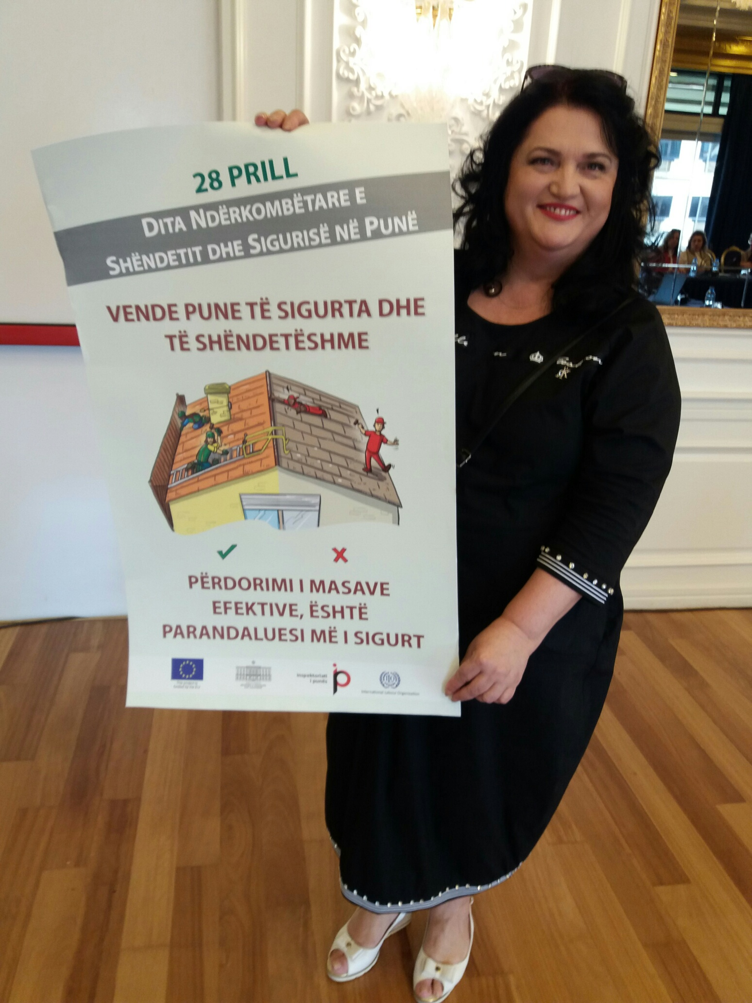 ILO National Coordinator in Albania, Zhulieta Harasani with poster for the Albanian labour inspection campaign